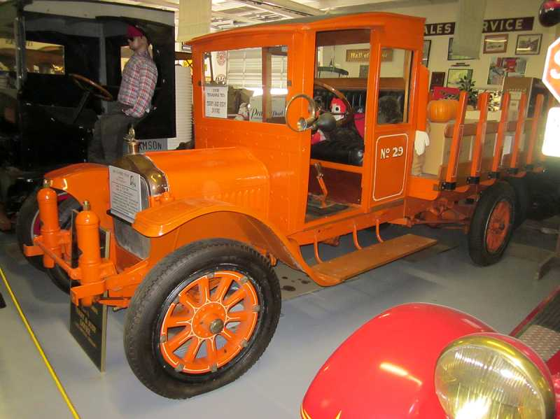 by: BARBARA SHERMAN - LABOR OF LOVE - Terry Dovre, president of the Pacific Northwest Truck Museum, and Ken Self, former Freightliner president and chairman, restored this 1914 White Motor Co. truck on display at the musuem.