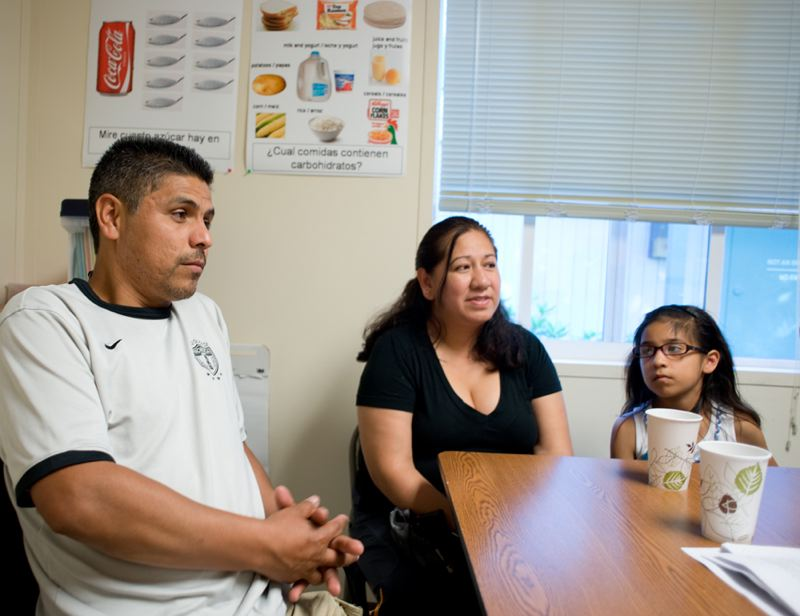 by: CHASE ALLGOOD - Osvaldo Martinez, his wife Alejandra Galicia and their daughter Alexa, 8, are patients at the Virginia Garcia Memorial Health Center in Forest Grove. They look forward to a day when, under the Obama administration's Affordable Care Act, they'll have full health insurance coverage.