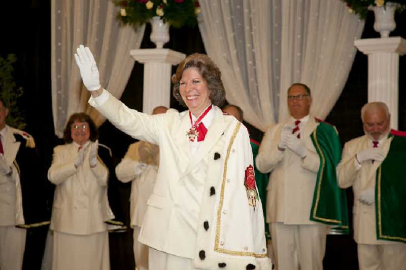by: SUBMITTED - Rosarian prime minister Gayle Whitehurst waves after receiving her new cape during the installation ceremony.