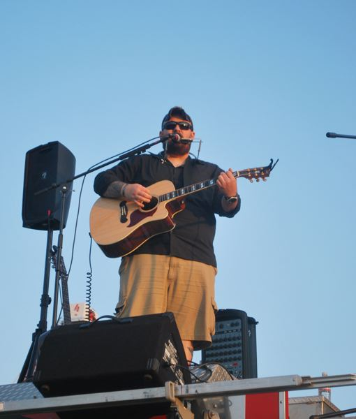 by: COURTESY FOREST GROVE FIRE & RESCUE - Singer-songwriter Josh Smith performed for the crowds at Forest Groves Fourth of July festivities earlier this year. This weekend hell take his brand of outlaw country to Ballad Town Billiards.