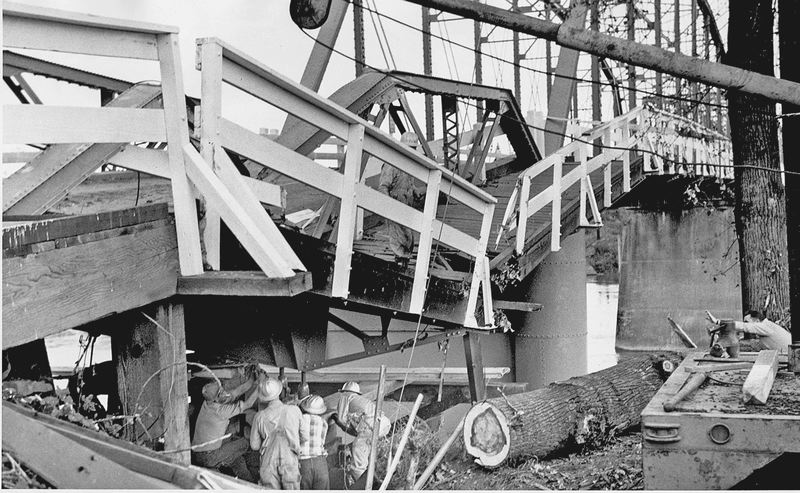 by: COURTESY OF OREGON STATE UNIVERSITY ARCHIVES - Workers examined the Van Buren Street Bridge in Corvallis after it was heavily damaged in the Oct. 12, 1962, Columbus Day Storm. The storm is a touchstone in Oregon's history.