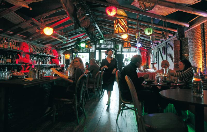 by: TRIBUNE PHOTO: JONATHAN HOUSE - The tiki-theme Hale Pele on Northeast Broadway, under new management, has a revamped cocktail menu.