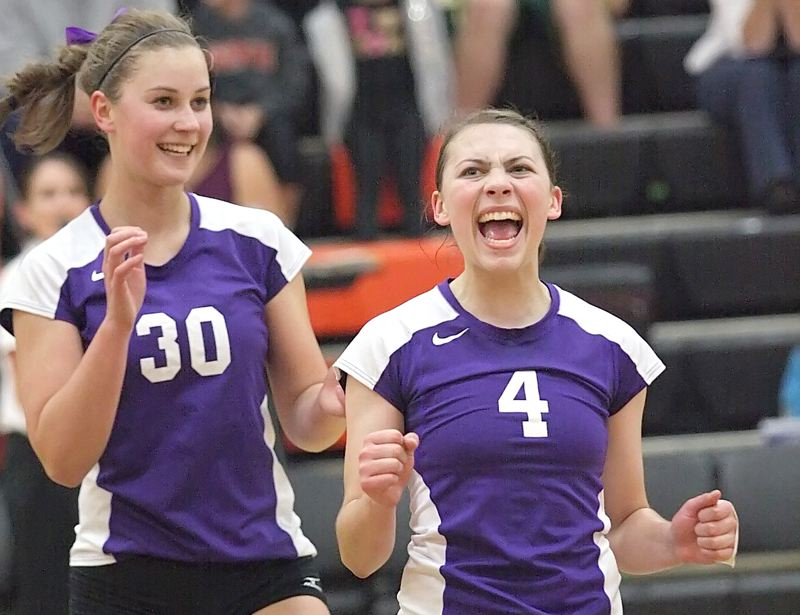 by: MILES VANCE - SCORE - Sunset setter Laurie Salness celebrates a point with teammate Megan DeMots on Tuesday.