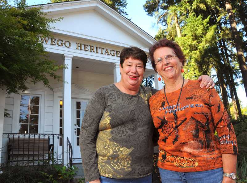 by: VERN UYETAKE - Anne Penfound, in front, and Sarah Hauser are ready to provide chills, thrills and fun Thursday at the Oswego Heritage House.