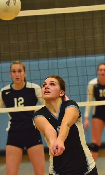 by: VERN UYETAKE - Lakeridge setter McKenna Moore gets ready to make a pass during last week's match against Lake Oswego.