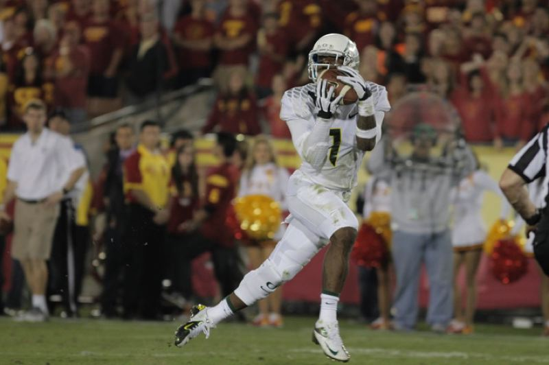 by: TRIBUNE PHOTO: JAIME VALDEZ - Josh Huff, hauling in a touchdown catch at USC, says it was fun to have so much offensive balance in a game won by Oregon 62-51.