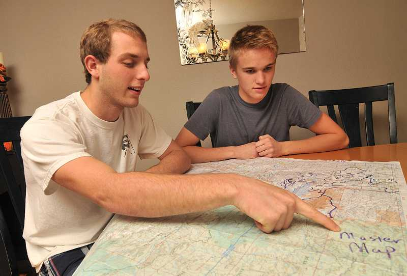 by: VERN UYETAKE - Jackson Chandler, left, and Bradley Nelson review a map that shows where search crews looked for them and where they were found.