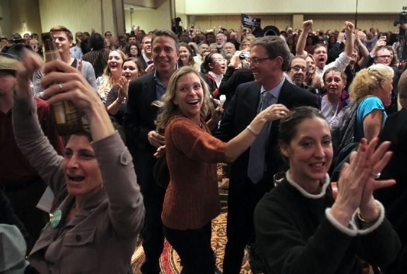 by: TRIBUNE PHOTO: JON HOUSE - Democrats celebrated Tuesday night as television networks projects the re-election of President Barack Obama. A number of Democrats across Oregon were victors in their races.