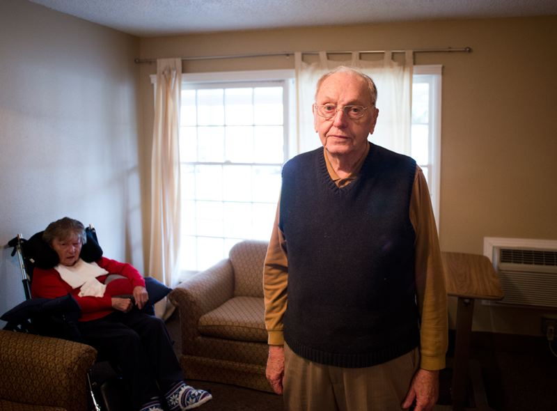 by: NEWS-TIMES PHOTO / CHASE ALLGOOD -  Morrie DeWolf, 90, visits his wife, Vera, at Marquis Care in Forest Grove. DeWolf, who served as an Army parachute jumper during World War II, returned unscathed from the Battle of Bastogne in Belgium.