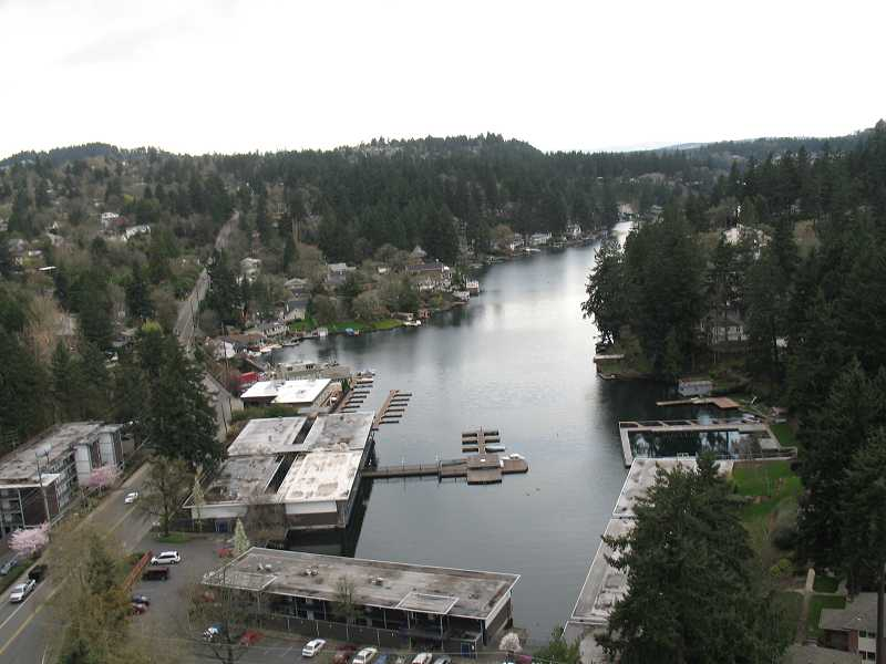 Oswego Lake, a roughly 400-acre water body maintained by a corporation of homeowners, is at the heart of a dispute between two enthusiasts of water recreation and the city.