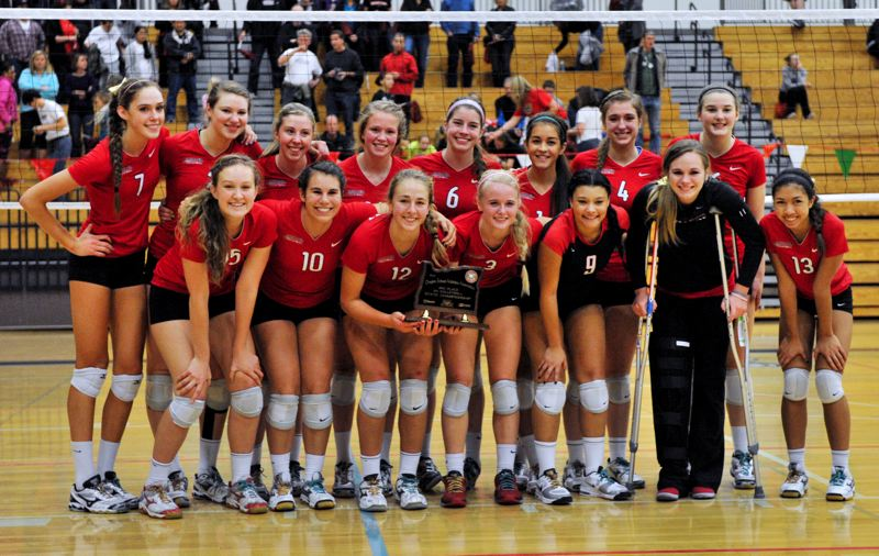 by: JOHN LARIVIERE - Clackamas High School volleyball players pose proudly with their hardware after knocking off top-ranked Central Catholic in Saturdays third-place final of the 2012 Class 6A State Championship Volleyball Tournament, contested over the weekend at Liberty High School. Pictured are: (first row, from left) Cassidy Scott, Claire Walker, Shelby Vasconcellos-Mattocks, Hannah Stultz, Kiana Miller, Sydney Wilson and Marissa Rhodes; and (back) Taylor Agost, Lauren OBrian, Emma Chizum, Shelby Torgerson, Caroline Combs, Tara Deaver-Noblisse, Kasey Toedtemeier and Bailey Bremer.