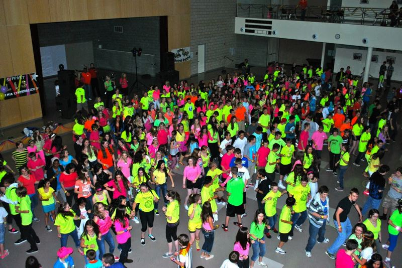 by: SUBMITTED - Happy Valley Middle School's Neon Night for the Leukemia and Lymphoma Society packs the gym last year as as fun benefit for research into the diseases that affect kids.