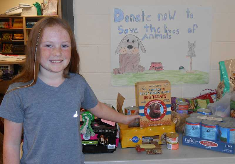 by: JORDY BYRD - Fifth-grader Grace McGovern donated $157 of her own money and started a school-wide drive for the Oregon Humane Society.