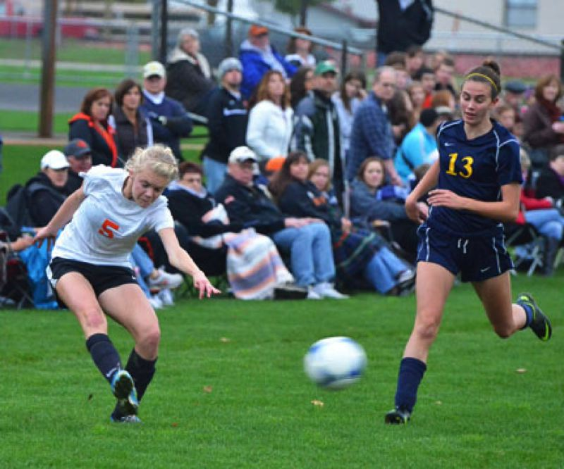 by: JOHN BREWINGTON - Scappoose's Charlie Davidson passed the ball to the goal mouth during the Lady Indians' match with Brookings-Harbor last week. Scappoose posted an easy 13-0 win to advance to their game with La Salle.