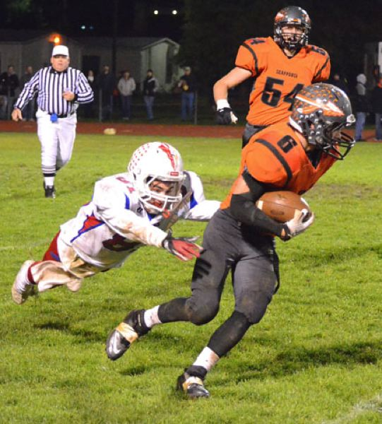 by: JOHN BREWINGTON - Scappoose's Paul Revis was tough to catch on Friday against Madras. Revis had three touchdowns, two on pass receptions, and one on an interception return.