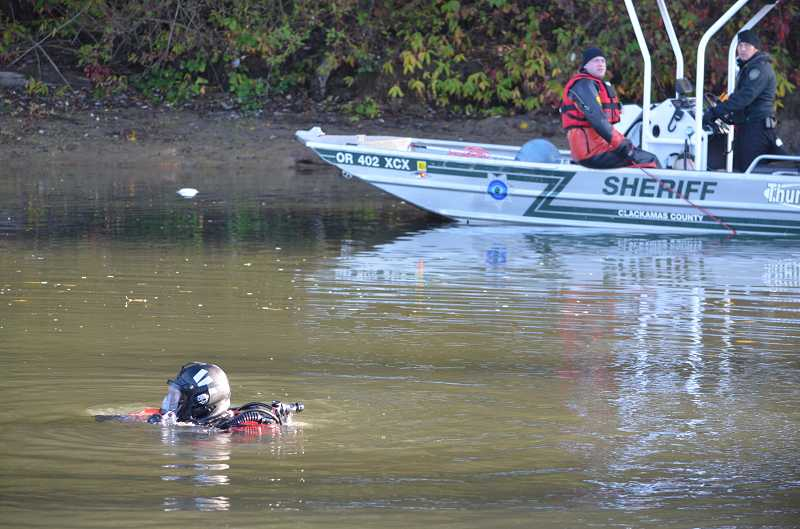 by: CLACKAMAS COUNTY SHERIFF'S OFFICE - Dive teams searched for the body of drowning victim Thomas Ermini, 53, of Milwaukie, on the Willamette River near Gladstone.