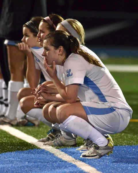 by: VERN UYETAKE - Lakeridge players watch nervously during penalty kicks in Tuesday's semifinal game with Clackamas.