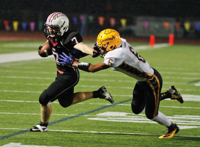 by: TRIBUNE PHOTO BY CHASE ALLGOOD - Glencoe senior Blaine Morgan stiff arms Barlow's Kennedy Johnson during a state play-in game on Nov. 2.