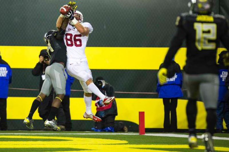 by: TRIBUNE PHOTO: CHRISTOPHER ONSTOTT - Zach Ertz, Stanford tight end, goes up for the touchdown catch to tie the game late in regulation at Oregon.