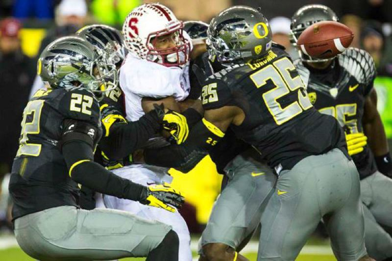 by: TRIBUNE PHOTO: CHRISTOPHER ONSTOTT - Oregon's defense forces a third-quarter fumble and Stanford turnover at Autzen Stadium.