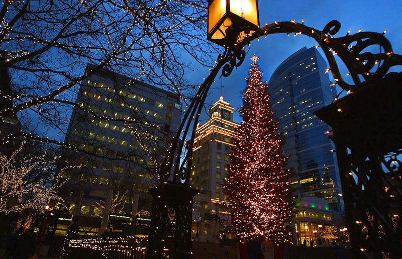 by: TRIBUNE FILE PHOTO - Portland's Pioneer Courthouse Square will host its annual Christmas tree-lighting ceremony Friday at 5:30 p.m. A sing-a-long led by Thomas Lauderdale and donations to the Oregon Food Bank donation are part of the annual program.