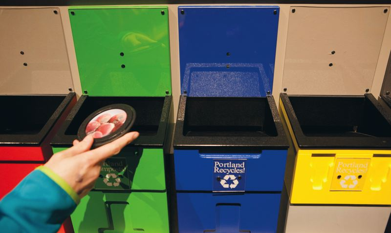 by: PAMPLIN MEDIA GROUP: CHRISTOPHER ONSTOTT - A new OMSI exhibit teaches visitors how to properly recycle.