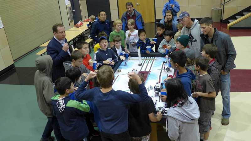 by: SUBMITTED PHOTO - West Linn First Lego League teams learned about aging firsthand with Elders in Action. Lego Megos, Team Electronic Lego Fanatics, The Robo Warriors, The River Bunnies, and Flying Lego Lizards showing off their robots in action.