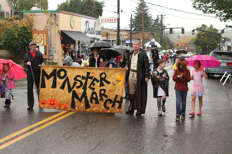 by: DAVID F. ASHTON - Todd Brugger and John Donovan carry the Monster March banner westward on S.E. Bybee Boulevard.