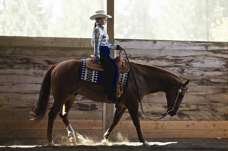by: JAIME VALDEZ - Maddie Fiorante and her quarter horse, Denny, won the overall circuit championship for Novice Youth at the 2012 Summer Classic. The pair won a Bob's saddle, as well as a buckle and various other prizes. She also competed in the 'Champion of Champions' class.