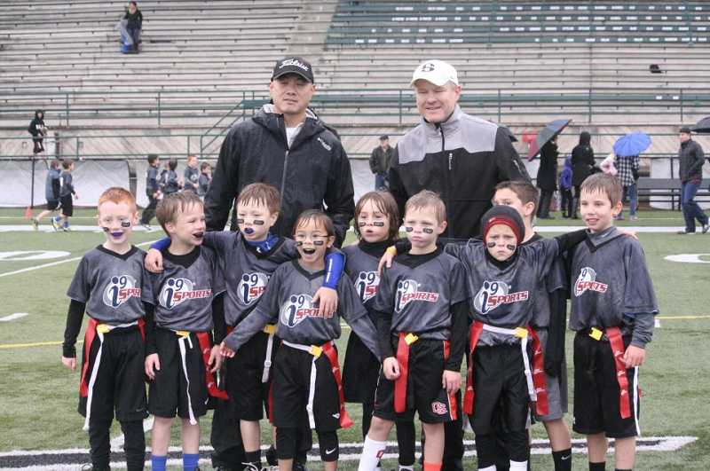 by: SUBMITTED PHOTO - Unable to play flag football, Coles teammates re-named their team Coles Bros in his honor, winning the championship trophy Nov. 11.