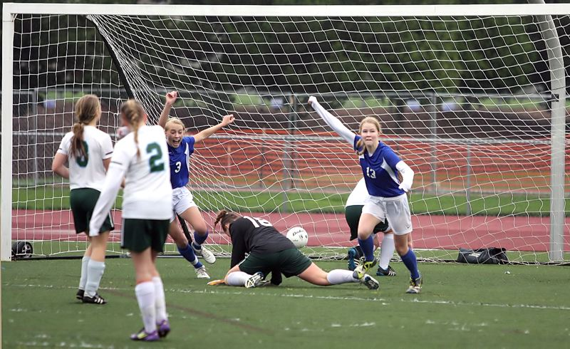 by: MILES VANCE - IT'S IN - Valley Catholic senior Claire McLoughlin (right) and teammate Reilly Blood celebrate McLoughlin's second-half goal during their state-championship loss to OES on Saturday at Liberty High School.