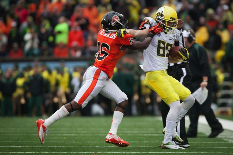 by: TRIBUNE PHOTO; CHRISTOPHER ONSTOTT - Rashaad Reynolds, Oregon State cornerback, gets an Oregon receiver out of bounds.