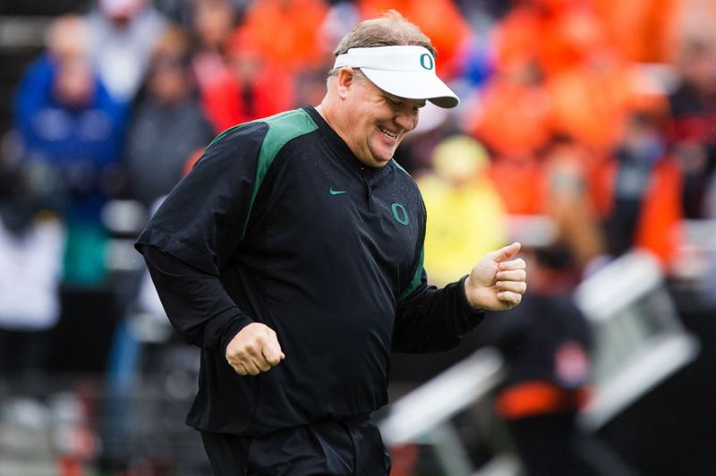 by: TRIBUNE PHOTO: CHRISTOPHER ONSTOTT - Oregon Ducks coach Chip Kelly enjoys the way his team comes back from its only loss of the season to win the Civil War for the fifth year in a row.