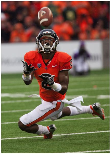 by: TRIBUNE PHOTO: MEG WILLIAMS - Oregon State's Markus Wheaton loses the handle on a punt, and Oregon recovers.