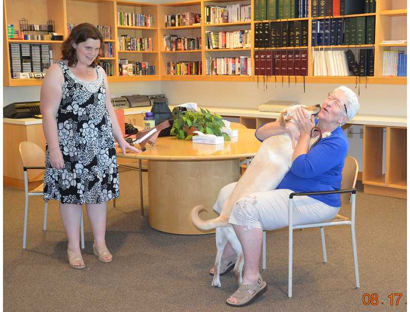 by: CHRIS CASEBEER/FOR THE REGAL COURIER - PURE JOY - Beth Allred (left) enjoys the exuberant reunion between Paige and Lou Travis, who had not seen each for for four months until just before Paige's graduation ceremony at the Guide Dogs for the Blind Boring campus.