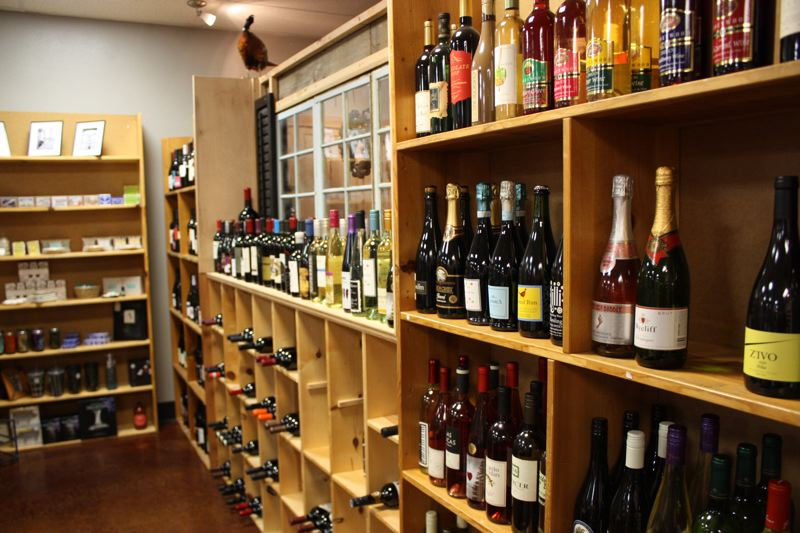 by: SPOTLIGHT PHOTO: ROBIN JOHNSON - Suzie Dahl, co-owner of Scappoose wine shop Avenue 30, said that aside from wine, her big holiday sellers have been handbags and accessories. Dahl says shes also had success selling hand-made tables and other furnishings.