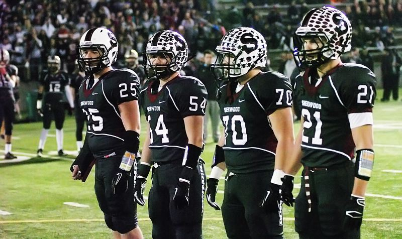 by: DAN BROOD - THE CAPTAINS -- Sherwood High School senior captains (from left) Scott Skurdahl, Andrew Rice, Nick Aspen and Keegan Lawrence, with all the rest of the Bowmen seniors lined up to their right, await the opening coin toss prior to Saturday's Class 5A state championship game.