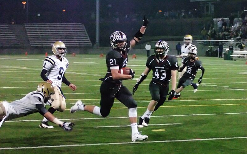 by: DAN BROOD - TO THE END ZONE -- Sherwood senior running back Keegan Lawrence (21), with fellow senior Tanner Shadbolt to his left, sprints to the end zone during overtime in Saturday's state championship game.
