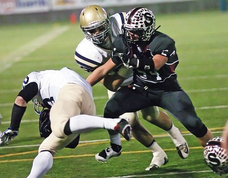 by: DAN BROOD - TAKEDOWN -- Sherwood High School senior linebacker Andrew Rice (54) looks to bring down West Albany running back Jake LaCoste in Saturday's Class 5A state championship game.