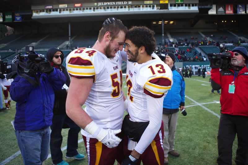 Central Catholic lineman Connor Humphreys and QB Aidan Wilder share a moment after defeating Jesuit to cap the Rams' 14-0 run to the state championship.