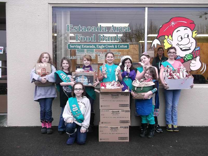by: CONTRIBUTED - Girl scouts Breanna Ruiz (back row from left), Jasmine Fairchild, Kaitlin Willis, Amber Haggstrom, Elizabeth Smith, Lily Belcher-McCoy, Lilly Mixon and (front row from left) Adelia Jeppeson,  Kaileigha Engeldinger took wrapped candy gifts to the Estacada Area Food Bank. Not pictured:  Lilly Cummings, April Herrod, Gabby Chassaing and Emily Hall.
