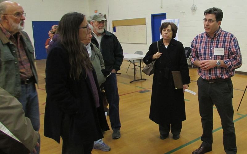 by: SPOTLIGHT PHOTO: MARK MILLER - Multnomah County senior planner Adam Barber, right, speaks with attendees from the public in the Sauvie Island Academy gymnasium at an open house Monday, Jan. 6, to discuss the county's plans to update the rural area plan for Sauvie Island and the Multnomah Channel.