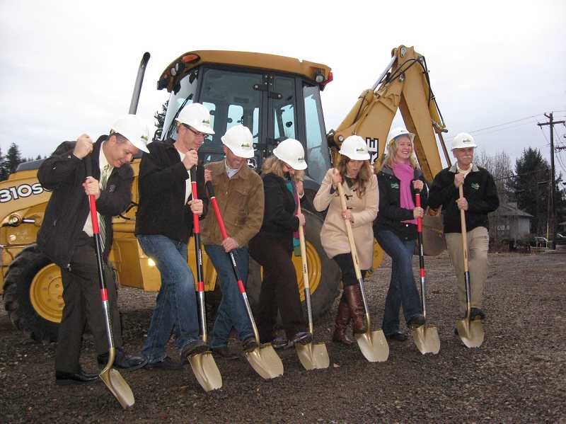 by: RAY PITZ - Members of the Sherwood City Council break ground on the new Sherwood Cultural Arts Community Center Friday afternoon.