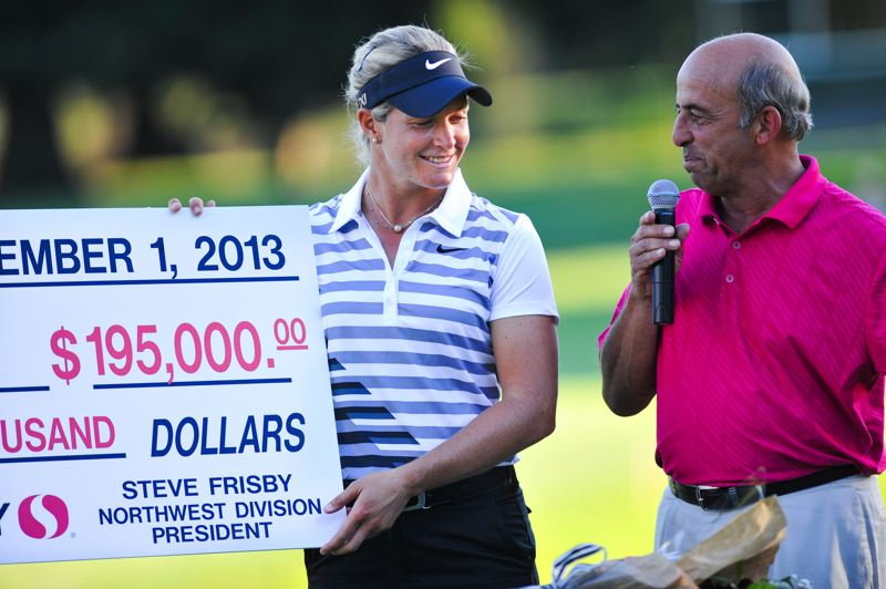 by: COURTESY OF JOHN LARIVIERE - Suzann Pettersen receives the winner's check from Tom Maletis of Tournament Golf Foundation after her LPGA victory last year at Columbia-Edgewater Country Club.