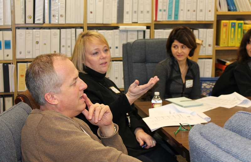 by: JILLIAN DALEY - During a Lake Oswego Schools Foundation campaign captain training meeting Friday, attendees, including, from left, Tom Krueger, Kathy LaVee and Laura James, discussed how to best approach potential donors.