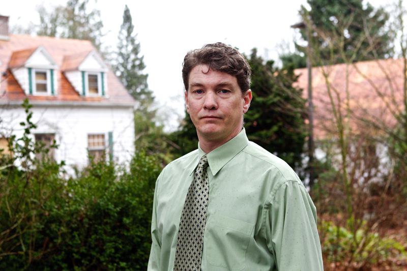 by: TRIBUNE PHOTO BY JAIME VALDEZ - Attorney Nick Merrill stands outside a large home in Southwest Portland that a developer wants to replace with three smaller ones.
