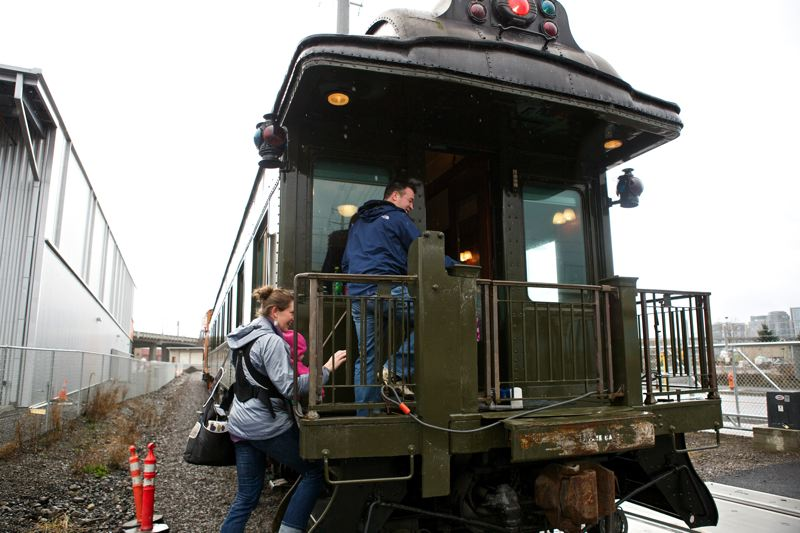 by: TRIBUNE PHOTO BY JAIME VALDEZ - Passengers aboard Pullman business rail coach car at the Oregon Rail Heritage Center.