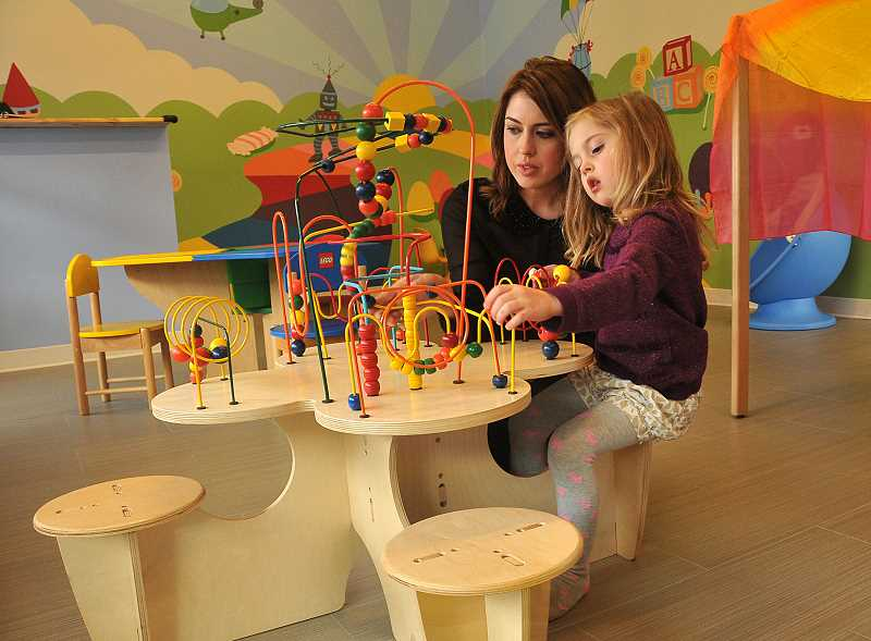 by: REVIEW, TIDINGS PHOTO: VERN UYETAKE - Faith Thomas and her 4-year-old daughter, Patience, demonstrate how much fun kids can have at Drop-N-Play, a new childcare center in Lake Oswego.