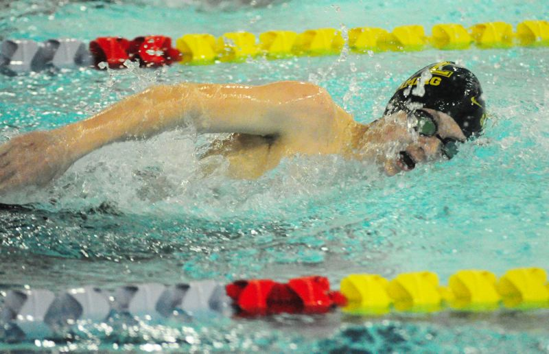 by: MATTHEW SHERMAN - West Linn's Zach Reid scored a narrow win in the 500 freestyle in last week's meet with Lake Oswego.