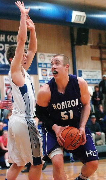 by: DAN BROOD - POWER POST -- Horizon Christian junior post Jace Prinzing looks to go up to the basket in Monday's game at Amity.